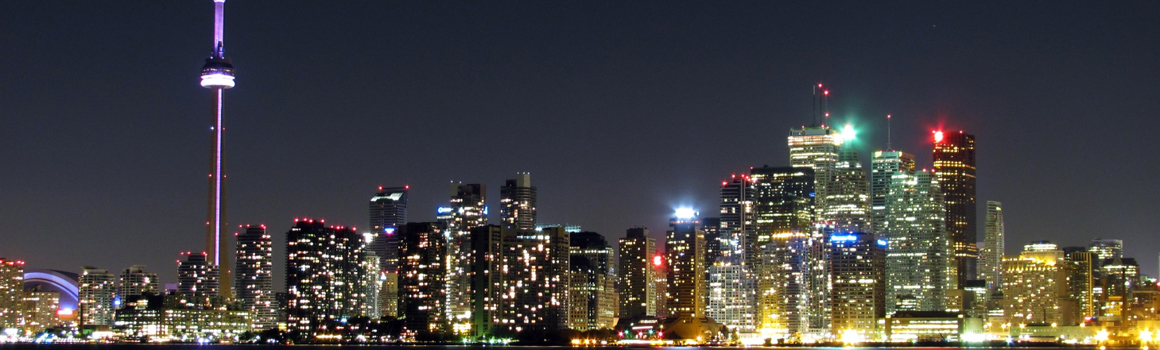 photo of the Toronto skyline at night seen from the harbour